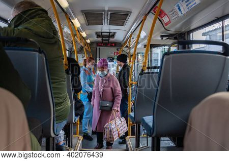 Krasnodar, Russia - January 5 2021: Passengers And Controller On The Bus Wearing Protective Masks
