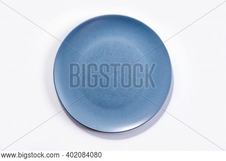 Empty Large Matte Navy Blue Plate Isolated On White Background Top View