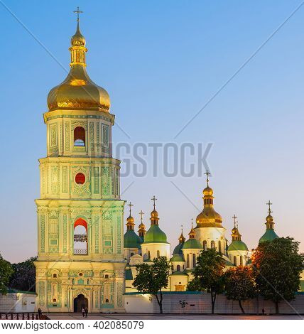 Saint Sophia's Cathedral With Bell Tower View At Twilight, Blooming Chestnut Trees And Afterglow Sky