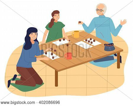 Happy Family Spend Time At Home. People Playing Bingo Lotto Game At Table. Mother, Daughter And Gran