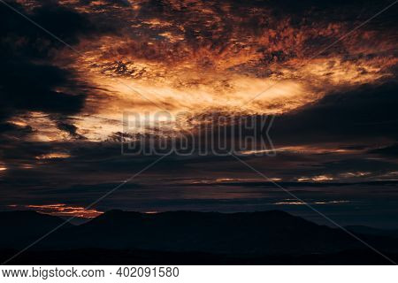 Beautiful Sky At Sunset. Red Clouds Looming Over The Beskydy Mountains. The Sky At Light Coral, Toma