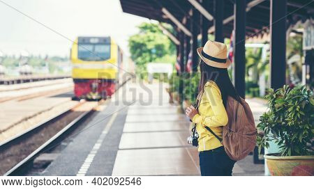 Traveler And Tourist Asian Young Women Wearing Backpack Holding Map Waiting Train For Leisure And De