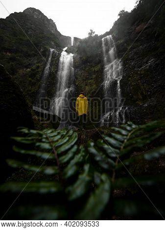 Young Man In Yellow Jacket In Front Of El Chorro De Giron Waterfall Cascade Cataract Near Cuenca Azu