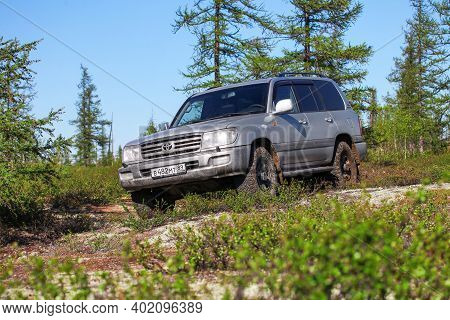 Novyy Urengoy, Russia - June 4, 2020: Grey Offroad Car Toyota Land Cruiser 100 In A Northern Tundra.
