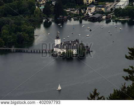 Panoramic View Of White Medieval Water Castle Schloss Ort Orth On Lake Traunsee In Gmunden Upper Aus