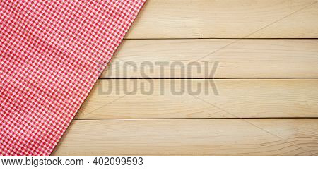 Classic Pink Plaid Fabric Or Tablecloth In The Corner Of Wood Desk With Copy Space