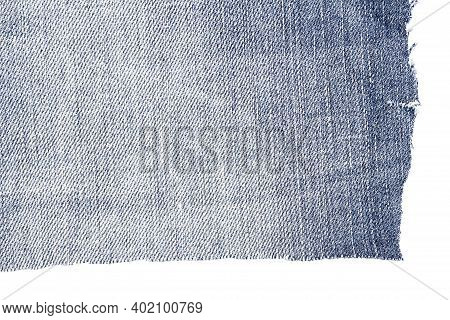 Cut Of Blue Jeans Fabric Isolated On White Background. Rough Uneven Edges. Denim Jeans Torn