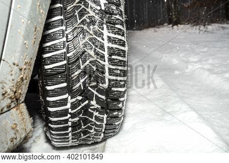 New Winter Tire In A Silver Car Standing On A Snow-covered Road In The Forest, A Visible Tread With