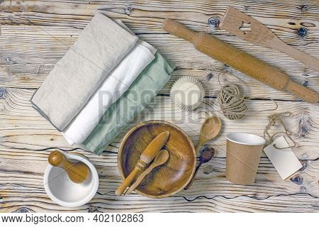 Eco Friendly Dishes And Kitchen Utensils Made Of Bamboo, Wood, Flax, Glass, Porcelain, Paper On A Wo