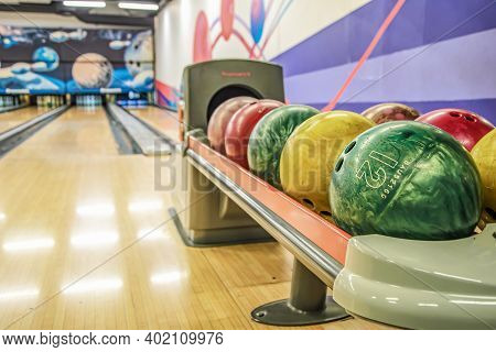 Bowling Balls Against Background Of Empty Lanes In Bowling Alley. Active Leisure. Sports Activities
