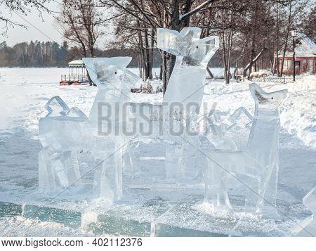 Kazan, Russia - January 3, 2021: Ice Sculptures Deer. Ice Installation. Sculptural Image Of Deer Mad
