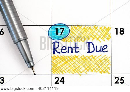 Reminder Rent Due In Calendar With Pen. Close-up