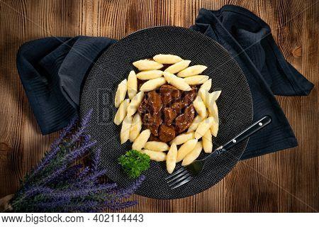 Beef Stew In Gravy, Served With Potato Dumplings.
