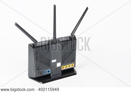 Rear View Of Gigabit Dual-band   Wi-fi Router With  Three Antennas. Wireless Device With Five Gigabi