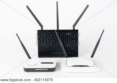 Three  Wi-fi  Routers, Wireless Devices With One, Two And Three Antennas.  Black Router Has Five Gig