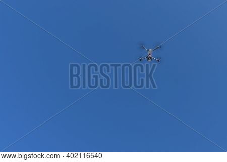 Drone Flies In The Air. Blue Sky