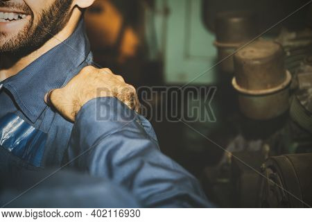 Mechanic Working In A Factory Is Frustrated With His Hard Work : Hands Of A Colleague Sat Around On