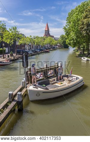 Montfoort, Netherlands - May 21, 2020: People In A Motorboat In Montfoort Village, Netherlands