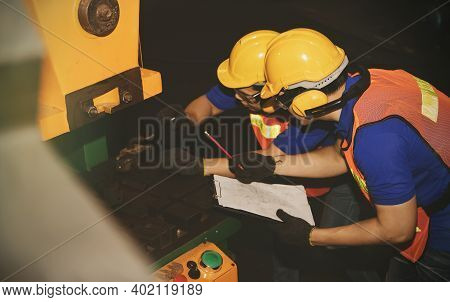 Monthly Inspection Of Safety Equipment : Engineering Workers, Engineers, Technicians Work As A Team