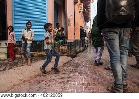 Mathura, Uttar Pradesh/ India- January 6 2020:young Kids Playing With Colors During Holi In The Stre