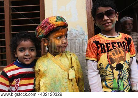 Mathura, Uttar Pradesh/ India- January 6 2020: Young Kids Playing With Colors During Holi In The Str