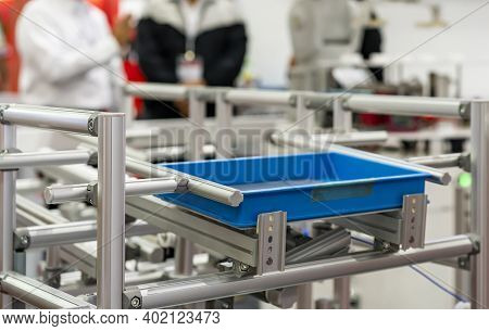 Basket Or Plastic Box Container On Roller Rack Or Aluminum Shelf For Easy Transfer For Industrial