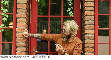 Cool Guy Relaxing. Hipster Smoking Old Architecture Background. Brutal Guy Sunglasses Smoking Tobacc