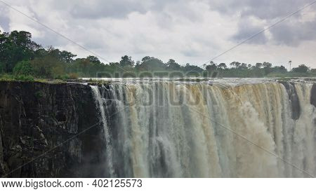 The Zambezi River Flows Across The Plateau And Falls Into The Gorge, Forming The Famous Victoria Fal