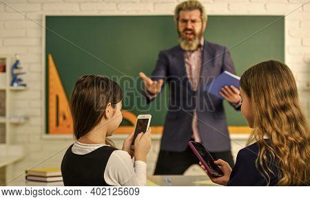 School Students And Teacher. Problem Of Smartphones In Schools. Have Fun With Smartphone Instead Stu