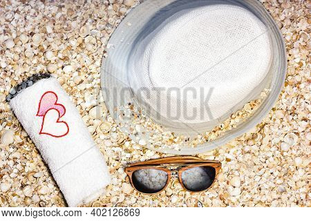 Summer Hat, Towel And Sun Glasses On Seashells. Background From Seashells. Summer. Relaxation