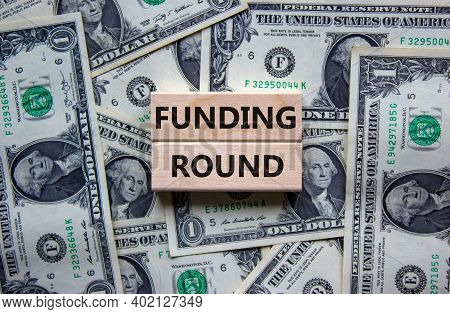 Funding Round Symbol. Concept Words 'funding Round' On Wooden Blocks On A Beautiful Background From