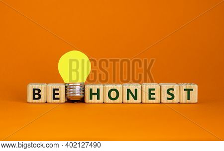 Be Honest Symbol. Wooden Cubes With Words 'be Honest'. Yellow Light Bulb. Beautiful Orange Backgroun
