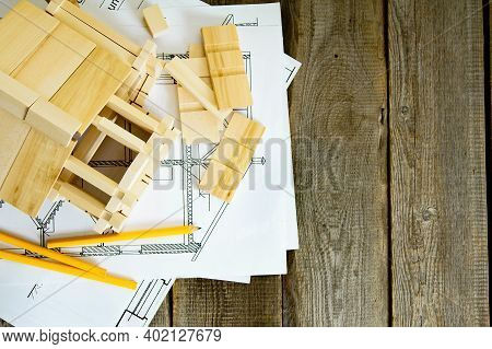 Building House. House Construction. Many Drawings For Building And Wooden House On Old Wooden Backgr