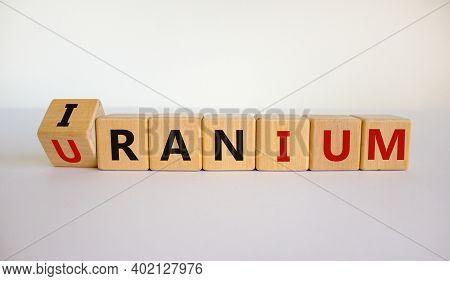 Uranium Enrichment In Iran Symbol. Turned Cubes With Words 'iran, Uranium'. Beautiful White Backgrou