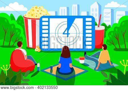Open Air Cinema Outdoor Movie Theater In Summer Park People Watching Movie In Open-air Cinema. Film