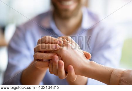 We Are Getting Married. Happy Fiance Holding His Future Wifes Hand With Engagement Ring On Finger, C