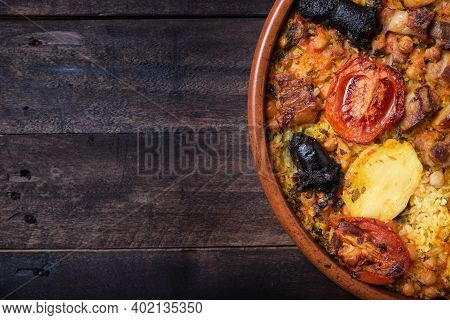 Appetizing Earthenware Casserole With Baked Rice, Tomato, Potato, Chickpeas