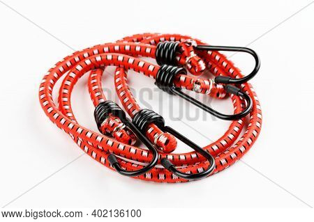 Elastic Rubber Rope With Hook On The End On A White Background.