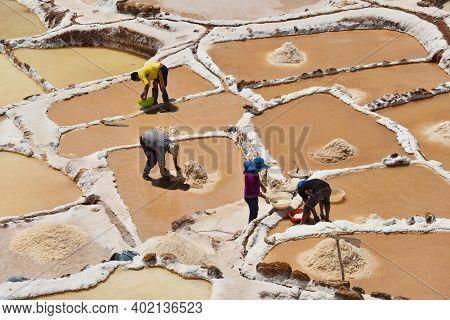 Maras, Peru - September 03, 2016: Unidentified People At Salt Evaporation Ponds At The Maras Salt Mi