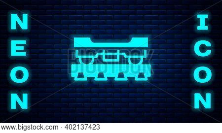 Glowing Neon Cargo Train Wagon Icon Isolated On Brick Wall Background. Freight Car. Railroad Transpo