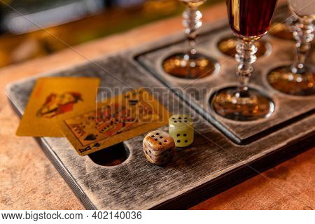 Gambling Concept With Booze, On Bar Table With Cards And Dice