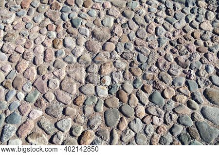 Stone-paved Surface, Pavement. Texture Of Stone Road, Pavement, Walls Of Large Gray.