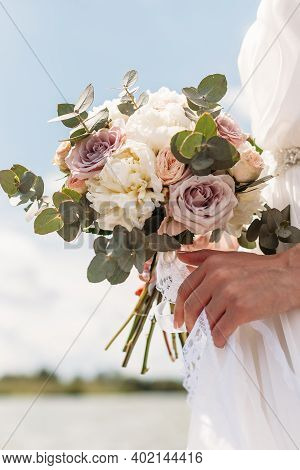 Bridal Bouquet. Beautiful Wedding Pink And White Flowers In Hands Of The Bride. Close Up Outdoor Sho
