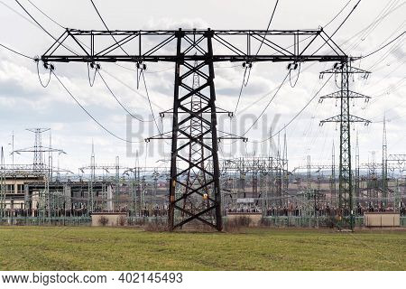 Electricity Pylons Conducting Current From Distribution Power Station, Solar Renewable Energy And Gr