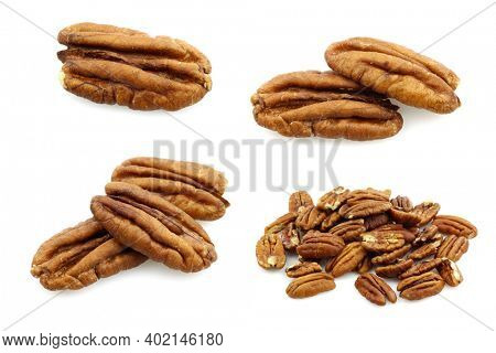 Roasted pecan nuts on a white background