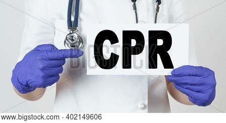 Medicine And Health Concept. The Doctor Points His Finger At A Sign That Says - Cpr. Cardiopulmonary