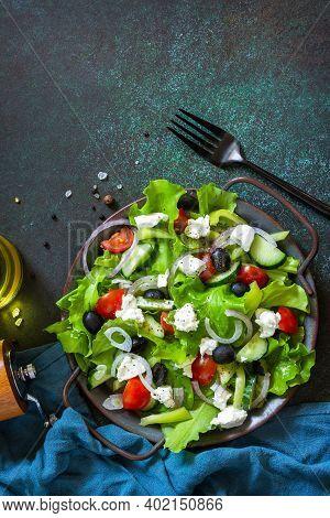 Healthy Diet Food. Greek Salad Of Feta Cheese, Fresh Cucumber, Tomato, Sweet Pepper, Lettuce, Red On