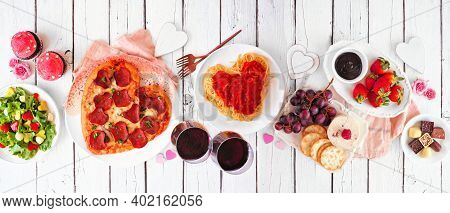 Homemade Valentines Day Dinner. Above View Table Scene On A White Wood Background. Heart Shaped Pizz