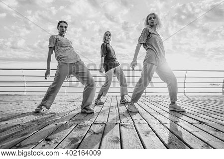 Dancing Group Of Young Talented Freak Women Performing Freestyle Hip-hop Moves. Females Enjoying Mod