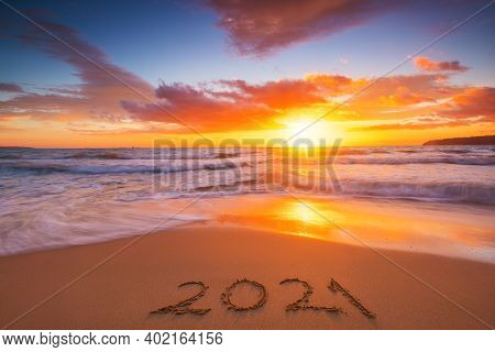 Happy New Year 2021 Concept, Lettering On The Beach. Written Text On The Sea Beach At Sunrise.